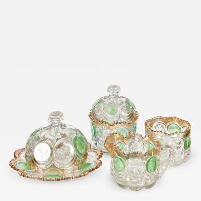Highly decorative Continental cut glass table set detailed in green and gold