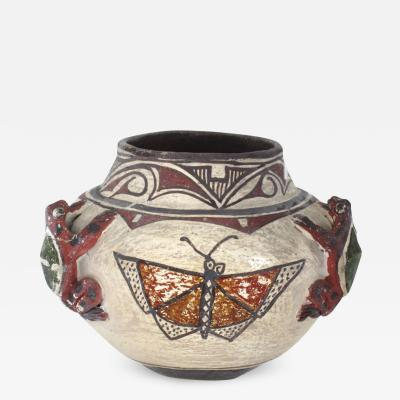 Historic Zuni jar with frogs and butterflies
