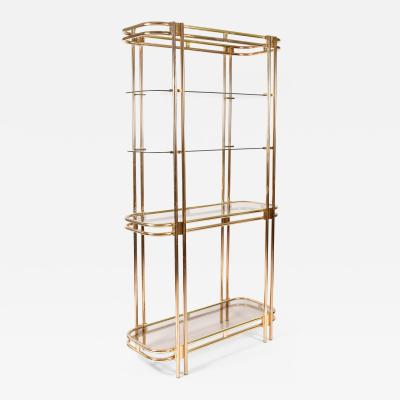 Hollywood Regency brass and glass shelving unit