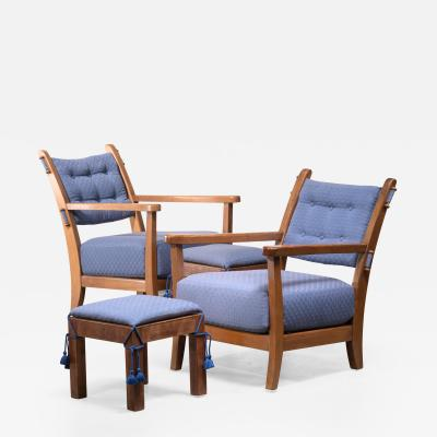 Hugo Gorge Pair of Hugo Gorge Bully chairs with matching ottomans