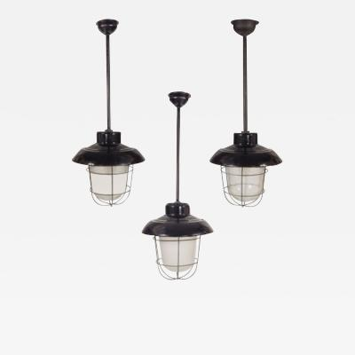 Industrial black enamel cage and glass globe lights