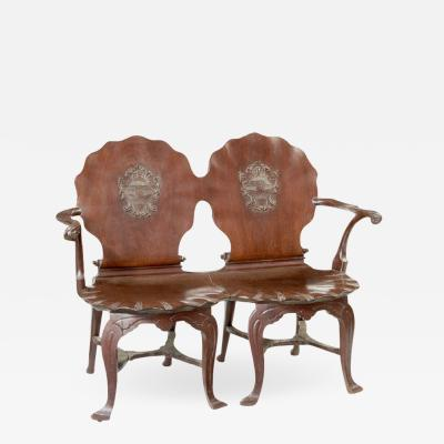 Irish George III mahogany double chairback hall settee
