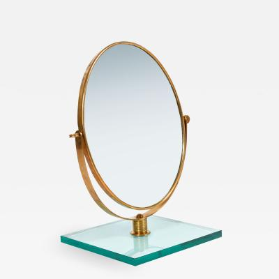 Italian 1950s brass table mirror on glass stand in the style of Gio Ponti