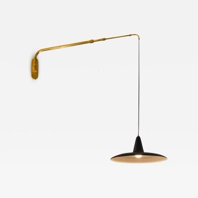 Italian School Extensible wall lamp with brass arm and black lacquered aluminum diffuser 1950s