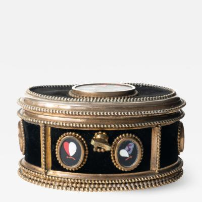 Italian oval jewelry cask in cast bronze and pietra dura with hinged lid