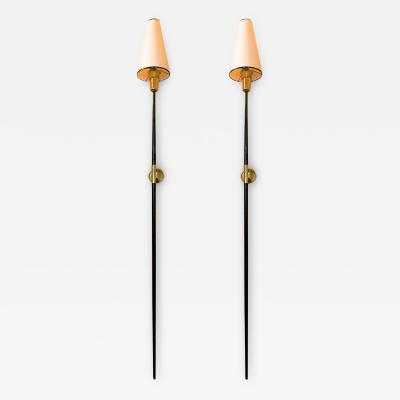 Italian stunning gold bronze and patinated iron pair of long torch sconces