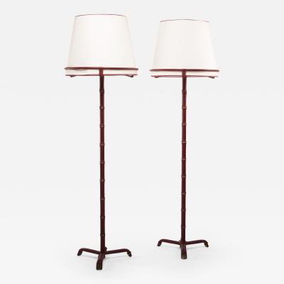 Jacques Adnet French Midcentury pair of floor lamps Jacques Adnet saddle stitched leather