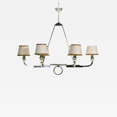 Jacques Adnet Jacques Adnet brass and gunmetal chandelier 1950 s