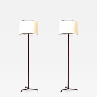 Jacques Adnet Jacques Adnet pair of tripod bordeaux hand leather standing lamps