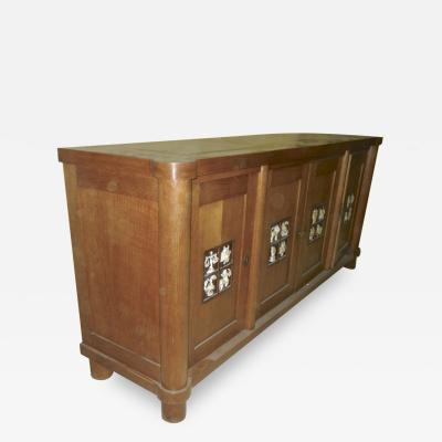 Jacques Adnet Jacques Adnet rarest oak cabinet with amazing ceramic zodiac signs