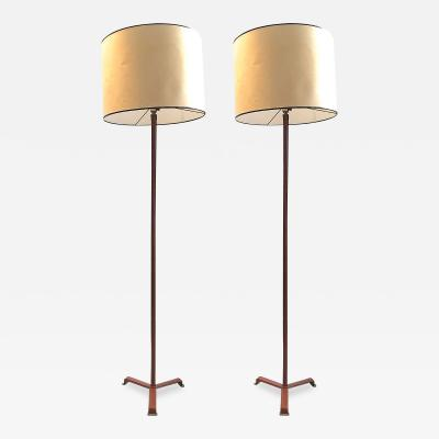 Jacques Adnet Jacques Adnet superb pair of brown hand stitched floor lamp with brass accent