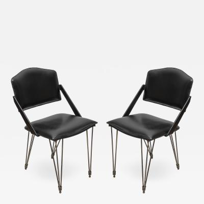 Jacques Adnet Pair oStitched Leather armchairs by Jacques Adnet