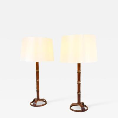 Jacques Adnet Pair of chic stitched leather table lamps