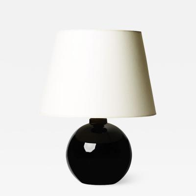 Jacques Adnet Petite table lamp by Jacques Adnet