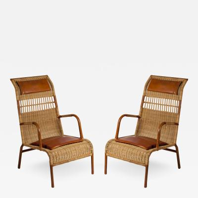 Jacques Adnet Stitched leather and rattan armchairs by Jacques Adnet