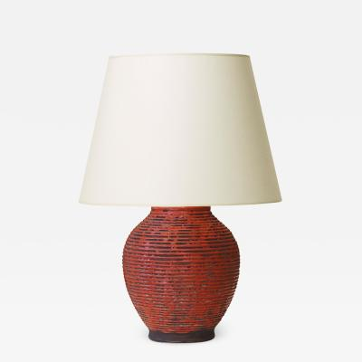 Jacques Adnet Table Lamp with Ridging and Scarlet Glaze in the Style of Jacques Adnet