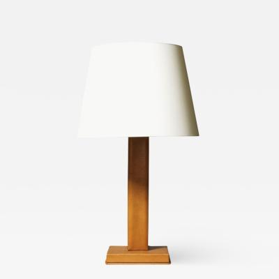 Jacques Adnet Table lamp in stitched leather by Jacques Adnet