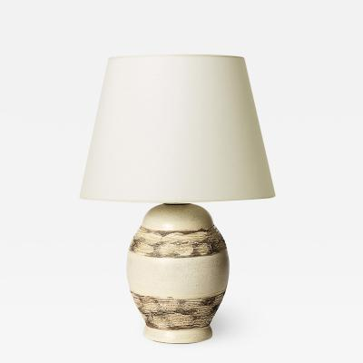 Jacques Adnet Table lamp with notched oval form attrib Jacques Adnet