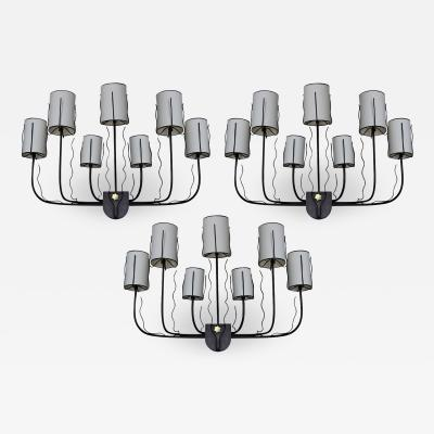 Jacques Adnet Three large 1950 s wall lights by Jacques Adnet France 1950