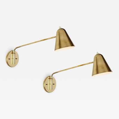 Jacques Biny Pair of 1950s Jacques Biny Brass Articulating Wall Lights