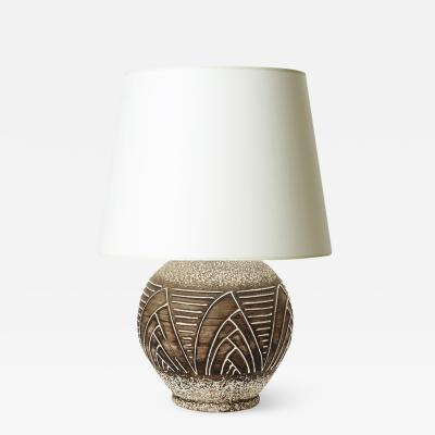 Jean Besnard Table lamp with relief of sail forms and lines in the style of Jean Besnard