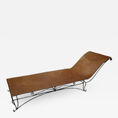 Jean Charles Moreux A Elongated Chaise Lounge in Wrought Iron and Raffia by Jean Charles Moreux