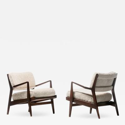 Jens Risom Jens Risom Walnut Lounge Chairs in Ivory Shearling circa 1950s