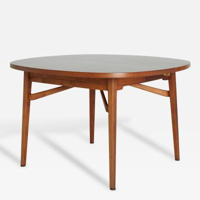 Jens Risom Round Expandable Dining Table by Jens Risom Marked