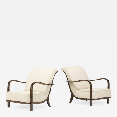Jindrich Halabala Pair of cypress lounge chairs in the manner of Halabala