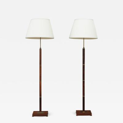 Jo Hammerborg Pair of Danish mid century rosewood and brass floor lamps