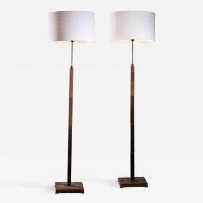 Jo Hammerborg Pair of Jo Hammerborg height adjustable wood and brass floor lamps