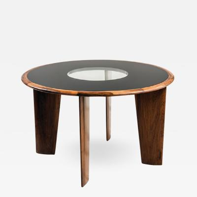 Joaquim Tenreiro Round dining table in jacaranda wood and painted glass