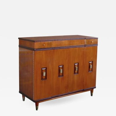 John Widdicomb A handsome and rare American walnut dressing cabinet by John Widdicomb