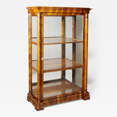 Josef Danhauser A Biedermeier display cabinet attributed to Josef Danhauser