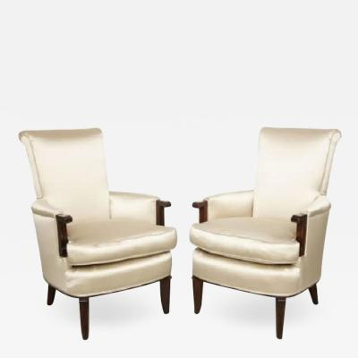 Jules Leleu Elegant pair of satin and walnut armchairs by Jules Leleu