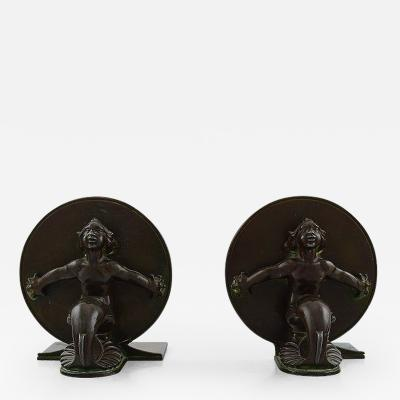 Just Andersen Two rare book stands in disko metal with sea men