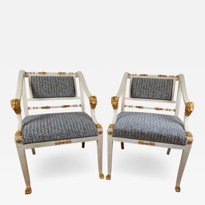 Karl Johan A Pair of Swedish Karl Johan Period Parcel Gilt and Cream Painted Armchairs