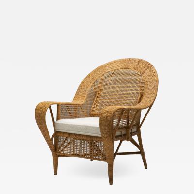 Kay Fisker Kay Fisker Canton Rattan Lounge Chair for Robert Wengler Denmark 1950s