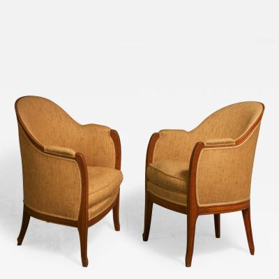 L on Jallot Leon Jallot Pair of Sculpted Pearwood Armchairs
