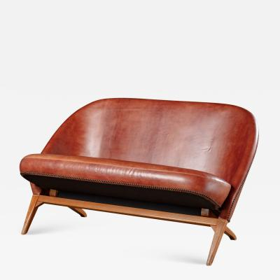 LEATHER UPHOLSTERED SETTEE