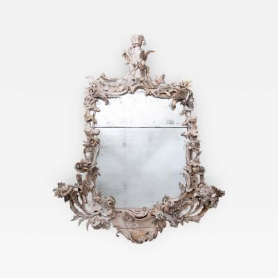 Large 18th century theatrical rococo mirror in the manner of Mathias Locke