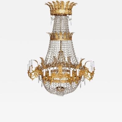 Large French Empire style glass and gilt bronze 18 light chandelier