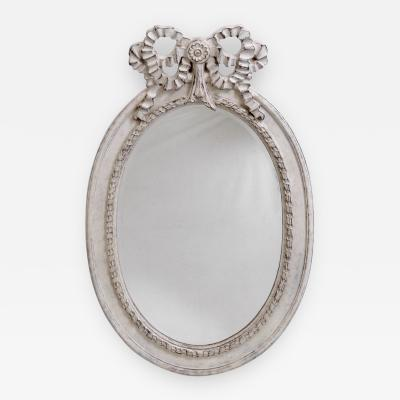 Large Gustavian style beveled mirror richly carved