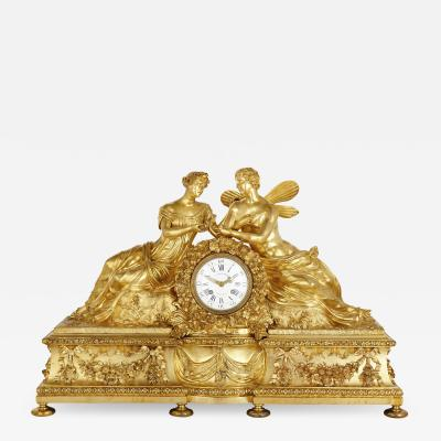 Large Neoclassical style gilt bronze mantel clock with Cupid and Psyche