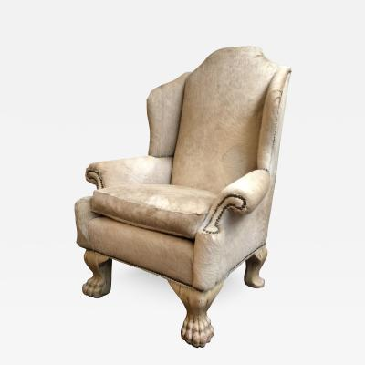 large wing chair upholstered in ivory pony hide