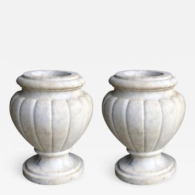 Large and Refined Pair of Italian Neoclassical Style Carved Carrera Marble Urns