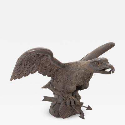 Large carved oak eagle with arrows in talons