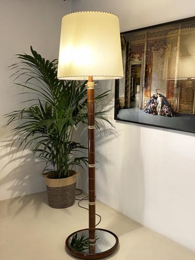 Large floor lamp with wooden stem brass and glass details mirrored base