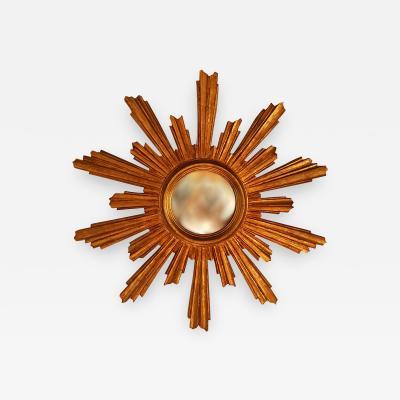 Large gilt wood sunburst convex wall mirror end 19th century France