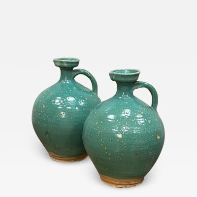 Large pair of turquoise green glazed jars